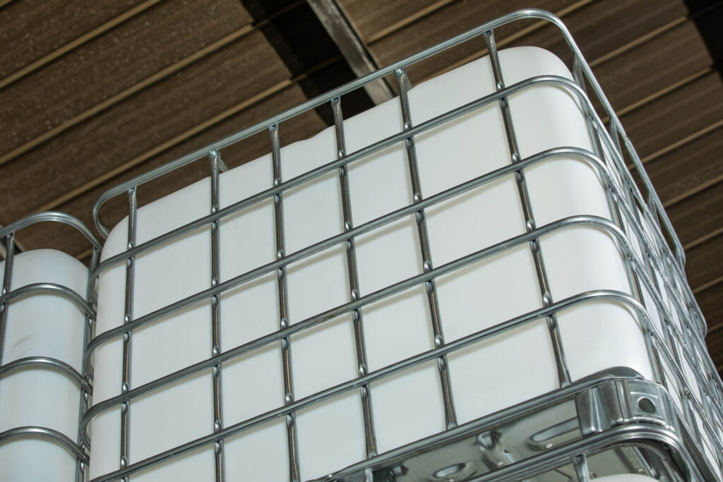 A closeup of a reconditioned IBC with a metal cage.