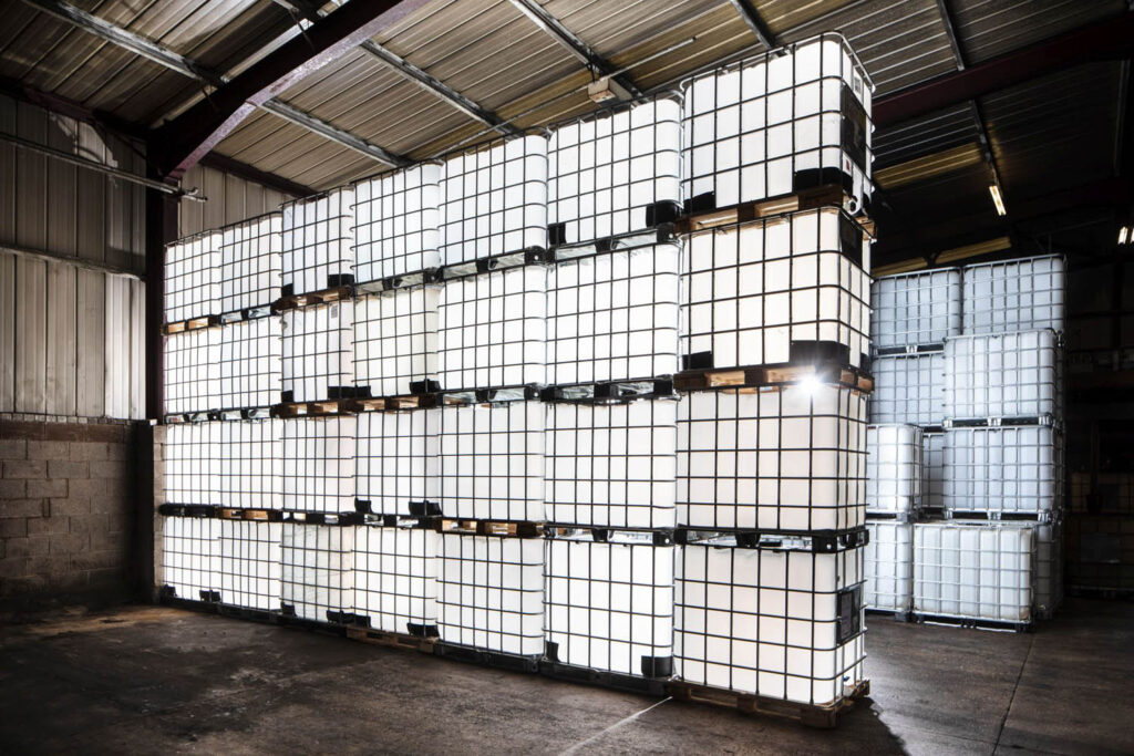 A row of reconditioned IBCs stacked four high in the Haslingden warehouse.