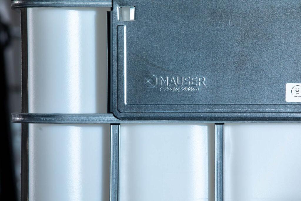 A closeup of a brand new Mauser IBC