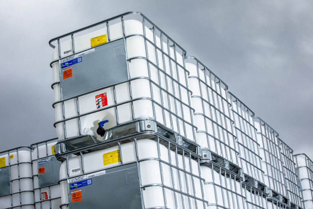 A tall stack of reconditioned earthed IBCs in the Recontainers yard