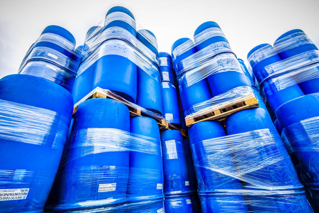Lots of blue 220L Drums, or L-Rings, on pallets ready for delivery.